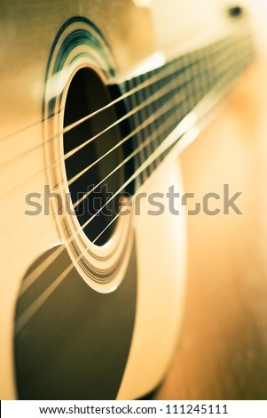 classic guitar with shallow depth of field - stock photo