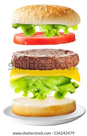 Classic hamburger on isolated background / Big hamburger with fresh ingredients. - stock photo