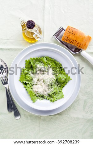 classic homemade Italian ravioli with spinach and ricotta, spring style - stock photo