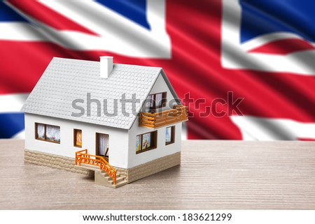 classic house against British flag background - stock photo
