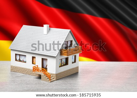 classic house against German flag background - stock photo