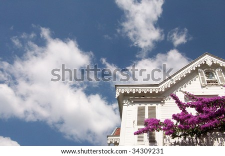 classic house and blue sky - stock photo