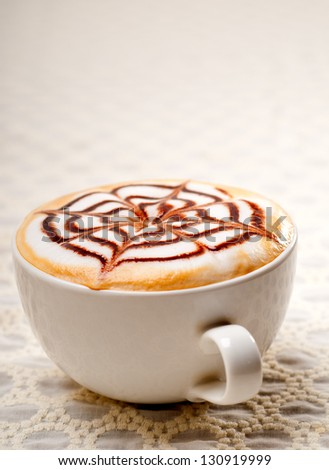 classic Italian cappuccino cup with topping decoration pattern - stock photo