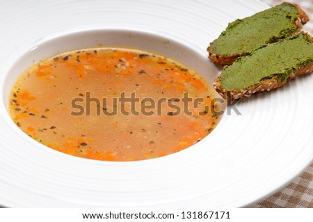 "classic Italian minestrone "" passato""soup with pesto crostini on side"
