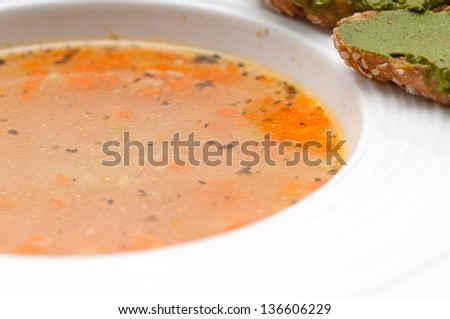 "classic Italian minestrone "" passato""soup with pesto crostini on side - stock photo"