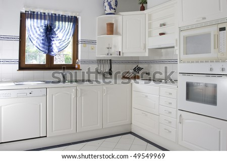 Classic kitchen with white wood and white tile - stock photo