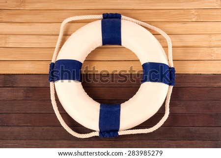Classic lifebuoy on a wooden planks.  - stock photo