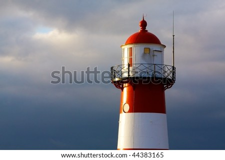 Classic lighthouse in sunset mood - stock photo
