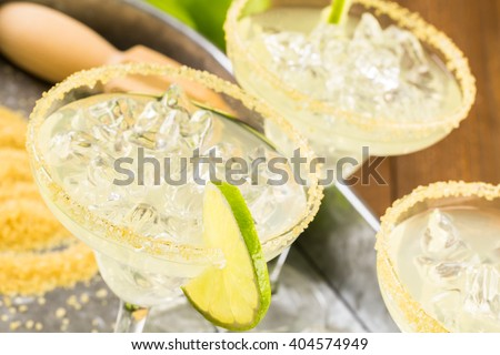 Classic lime margaritas on the rocks. - stock photo