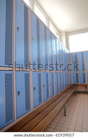 classic locker room with light blue rows of lockers - stock photo