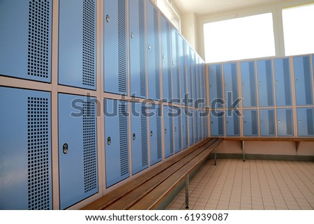 classic locker room with light blue rows of lockers