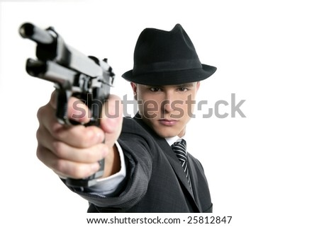 Classic mafia portrait, man with black suit and gun, isolated on white - stock photo