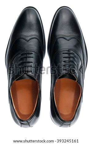 Classic male black leather shoes isolated on a white, top view - stock photo