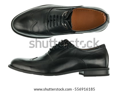 Classic male black leather shoes isolated on a white. Top view. Side view