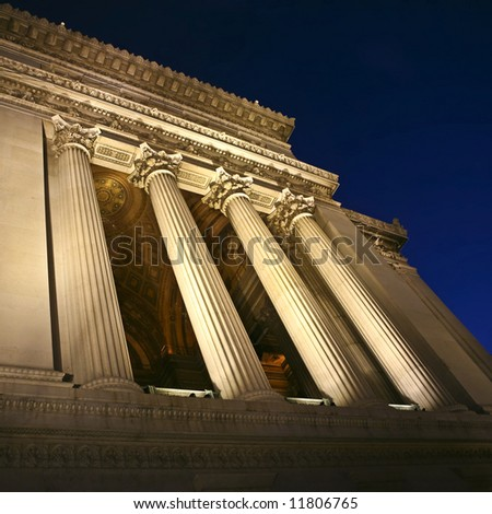 Classic marble colonnade by night - stock photo