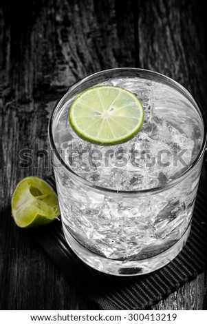 Classic margarita cocktail on wooden table with limes,Black and White - stock photo