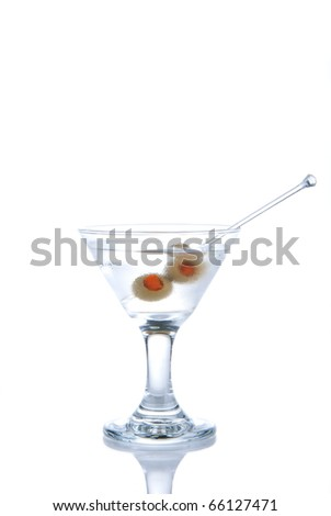 Classic Martini cocktail with Gin, dry vermouth, three olives with red pepper isolated on a white background
