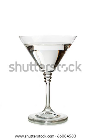 Classic martini glass filled with clear transparent drink - stock photo