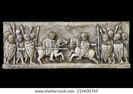 Classic medieval frieze showing a knights battle isolated on black background. Clipping path - stock photo
