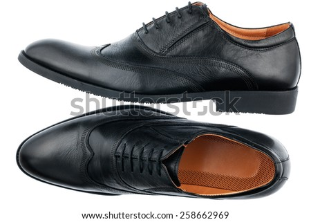 Classic men's black shoes, isolated on white background - stock photo