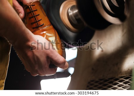Classic men's elegance, stitched shoes at the cobbler - stock photo