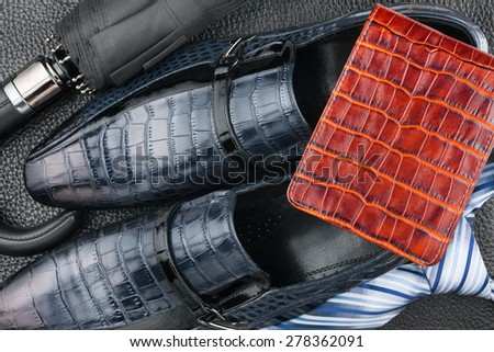 Classic men's shoes, tie, wallet, umbrella on the wooden floor, can be used as background - stock photo