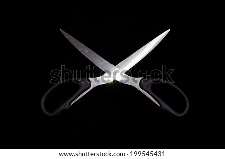 Classic Metal Scissors Isolated on a Black Background - stock photo