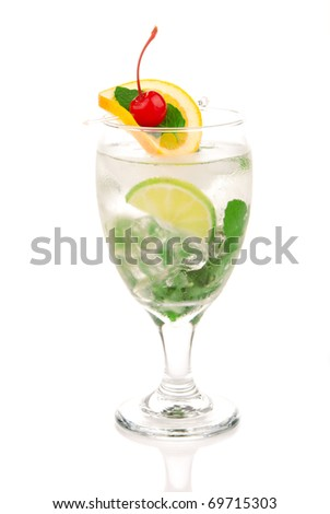 Classic Mojito cocktail summer drink with light rum, lime, spring of mint, orange, cherry, simple soda and syrup in cocktail glass isolated on a white background