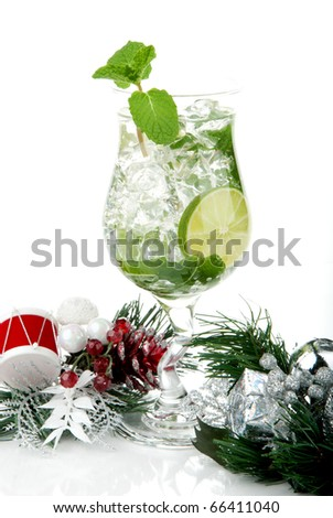 Classic Mojito cocktail with christmas ornament, mint leaves, lime, syrup, light bacardi rum, sprite soda and  isolated on a white background - stock photo