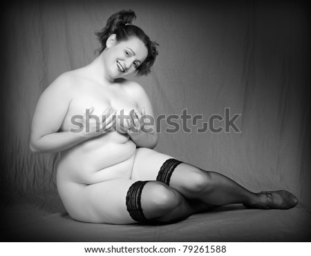 Classic monochrome shot of happy overweight woman. - stock photo