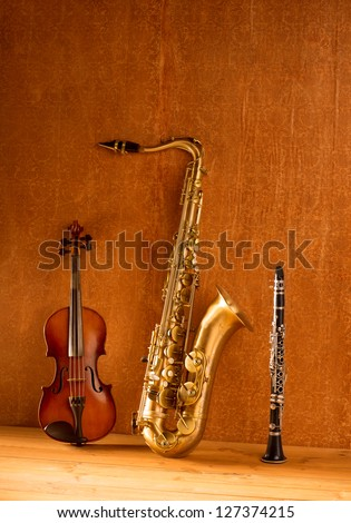 Classic music Sax tenor saxophone violin and clarinet in vintage wood background - stock photo