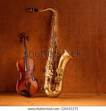 Classic music Sax tenor saxophone violin  in vintage wood background - stock photo