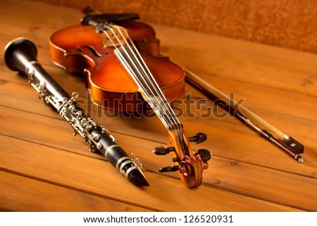 Classic music violin and clarinet in vintage wood background - stock photo