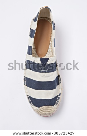 classic navy espadrilles shoe in pan isolated - stock photo