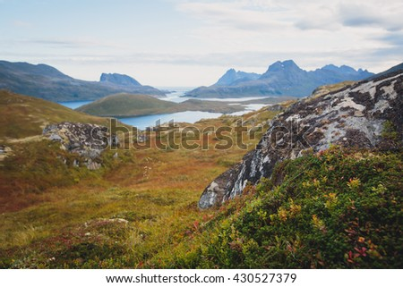 Classic norwegian scandinavian summer mountain landscape view with mountains, fjord, lake with a blue sky, Norway, Lofoten Islands - stock photo