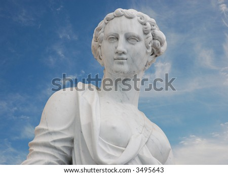 Classic Nymph Statue against blue sky - stock photo