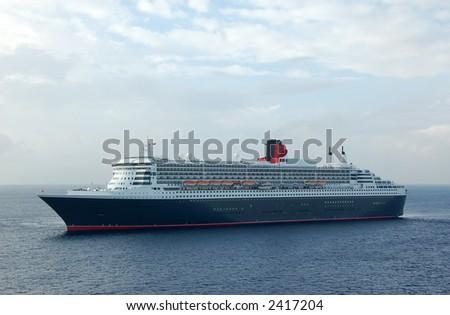 Classic ocean liner in exotic seas - stock photo