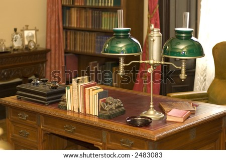 Classic oil lamp on antique office desk in historic George Brown House, Toronto, Ontario, Canada - stock photo