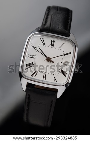 Classic old fashion wrist watch on black background