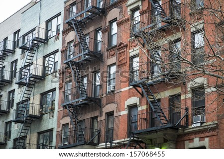 Classic old New York City apartment buildings with fire escapes - stock photo