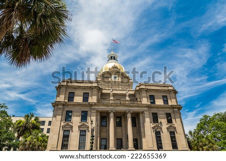 Classic old Savannah, Georgia City Hall with Gold Dome and American Flag - stock photo