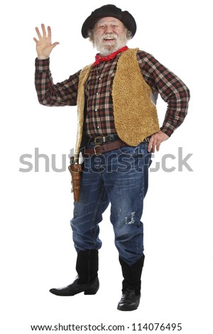Classic old west smiling cowboy with felt hat, grey whiskers, revolver, stands and waves. Isolated on white background, copy space, vertical. - stock photo