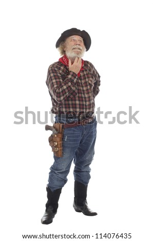 Classic Old West style cowboy with felt hat, grey whiskers, revolver, stands scratching his whiskers. Isolated on white background, copy space, vertical. - stock photo