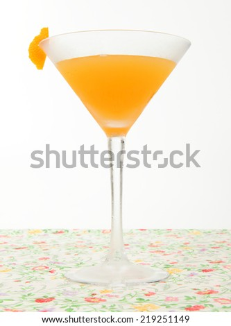 Classic Orange Blossom cocktail/Orange Blossom/A photo of a classic Orange Blossom cocktail on a pretty floral cloth with white background - stock photo
