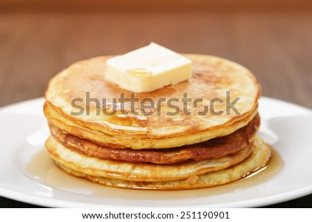 Classic pancakes with butter and syrup - stock photo