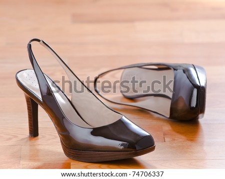 Classic patent leather shoes on wood floor background - stock photo
