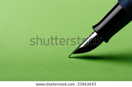 Classic pen on colored paper. - stock photo