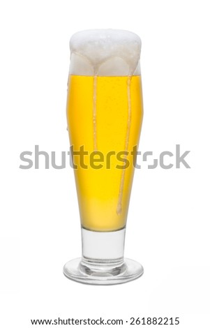 Classic Pilsner Beer with Foam Head and Drips Running Over Rim #4 - stock photo