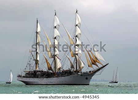 classic pirate-ship sailboat on the sea with cloudy background - stock photo