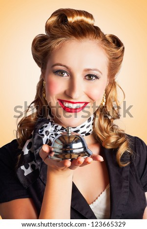 Classic Portrait From The Fifties With A Woman Holding A Silver Service Bell In A Depiction Of First Class Old-Fashioned Service With A Smile - stock photo